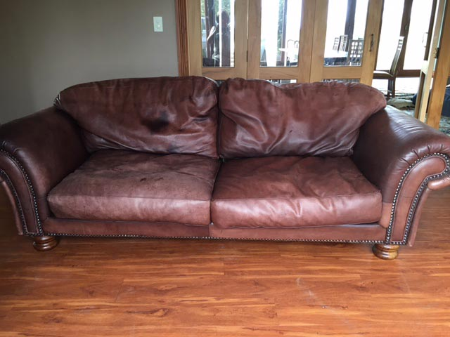 faded leather on couch