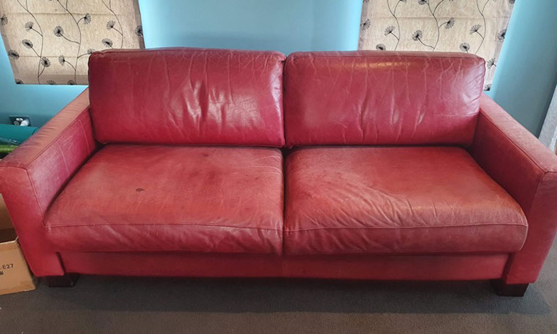 faded red leather sofa