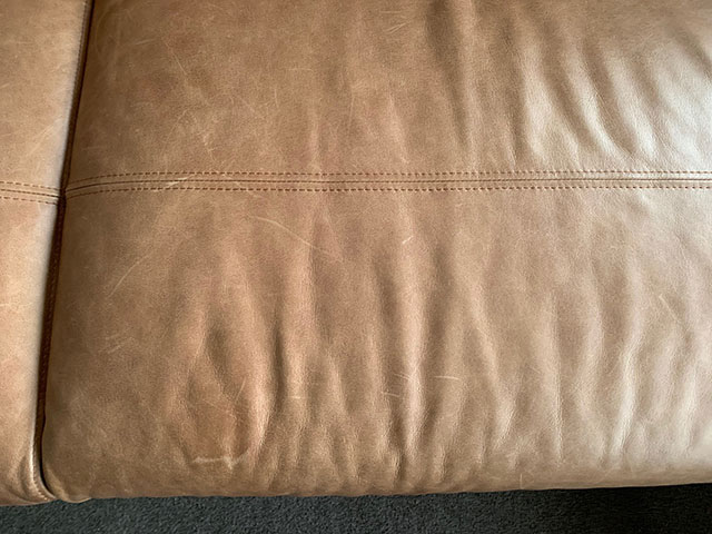 scratched, dry leather couch