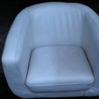 half cleaned leather tub chair