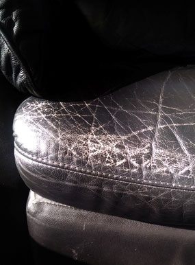 cracked black leather chairs