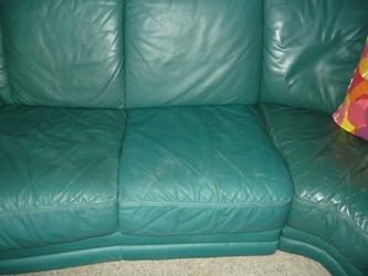 scruffy green leather couch