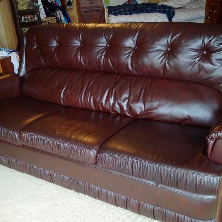 worn out leather couch after