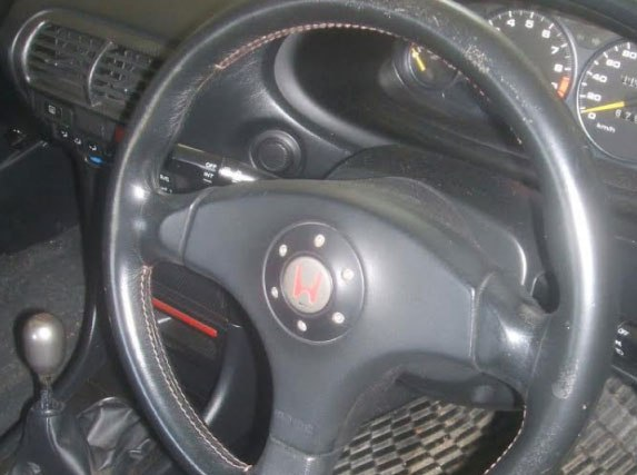 leather steering wheel showing scratches and wear