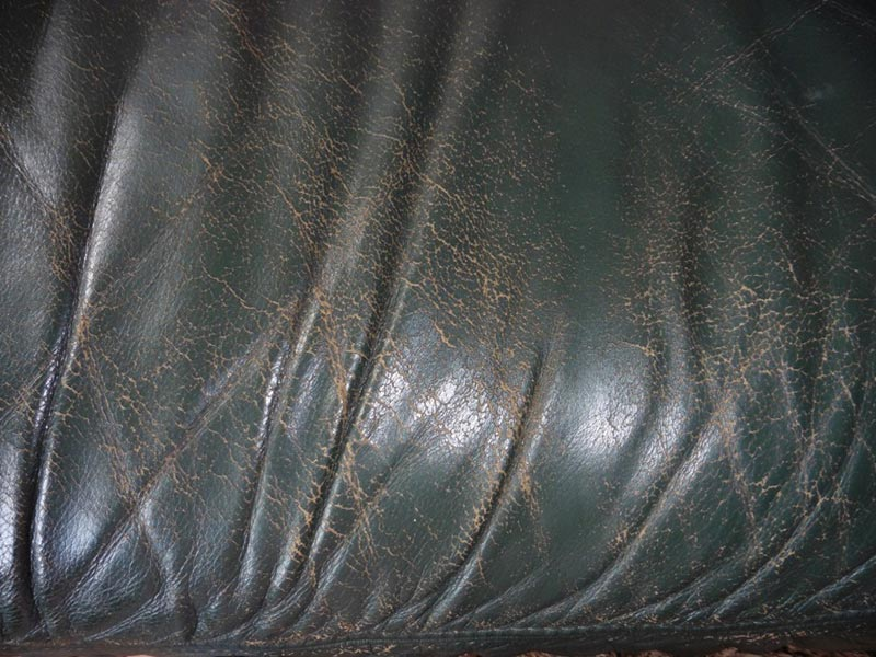 Green leather sofa before