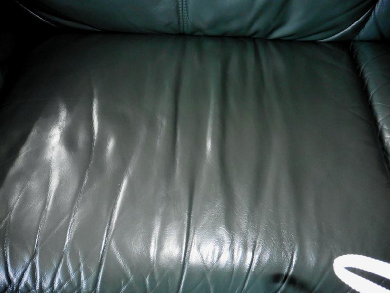 Green leather sofa after
